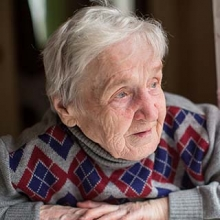 Older woman with Alzheimer's looking out a window
