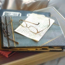 Photo album and glasses on a hospital bed