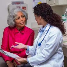 Older woman listening to her doctor