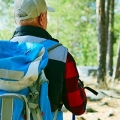Older man hiking in the woods.