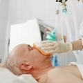 Male patient with sedation mask