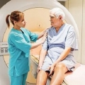 Nurse with patient in front of MRI