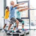 Several older adults doing step exercises
