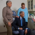 Older man with his 2 daughters at a doctor's appointment