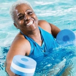 Older woman doing water aerobics