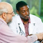 older man discussing sensitive subjects with his doctor