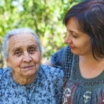 An older woman with her family caregiver