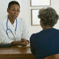 Doctor discussing frontotemporal disorders with an older woman