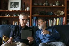 Two men looking at a tablet