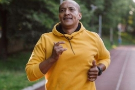African American man jogging on a track