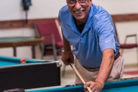 Man over 60 playing pool