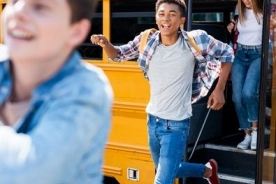 teenagers exiting a school bus