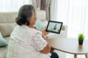Older woman has a virtual health visit with her doctor to talk about dementia