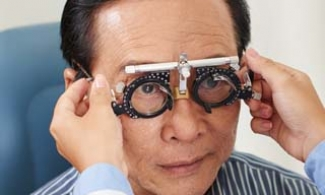Older Asian man during an eye exam