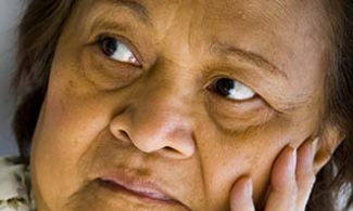 Older woman with Alzheimer's looking concerned