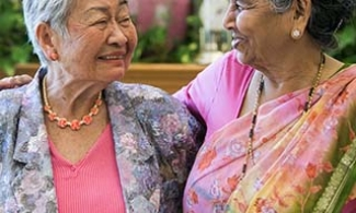 Asian Indian and East Asian women laughing