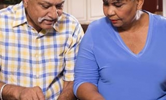 Older couple filling out paperwork like advance directives and wills