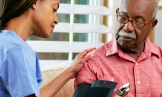 Older man getting blood pressure checked by a nurse