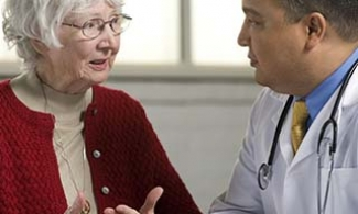 Older woman and her doctor having a serious conversation