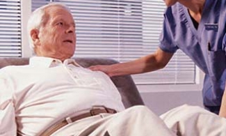 Physical therapist treating an older man with lewy body dementia