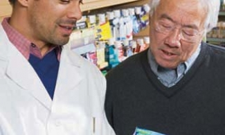 Older man talking to pharmacist about medicine