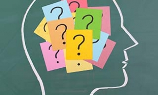 Outline of a head with question marks on colorful sticky notes where the brain would be.