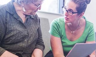 Older woman learning about organ donation from a social worker