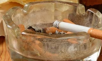 Risks to cognitive health including a cigarette in an ashtray, potato chips, and beer