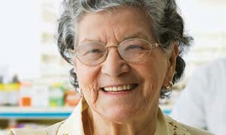 older woman at a pharmacy