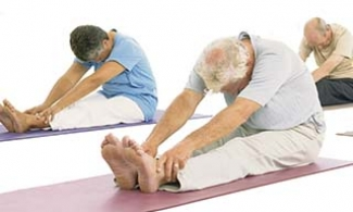 3 older adults doing yoga stretches