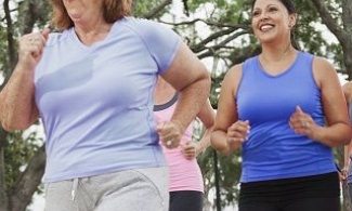 Group of women in exercise clothes walking briskly outdoors