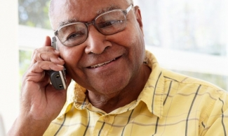 Alzheimer's caregiver calling ADEAR Center for information and referral services