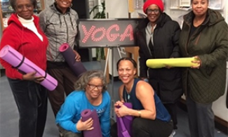 Older adults with yoga mats at a library